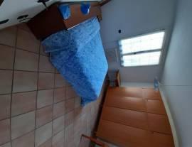 Stanza arredata con bagno privato