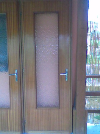 Porta interna in Mogano con vetri e maniglie