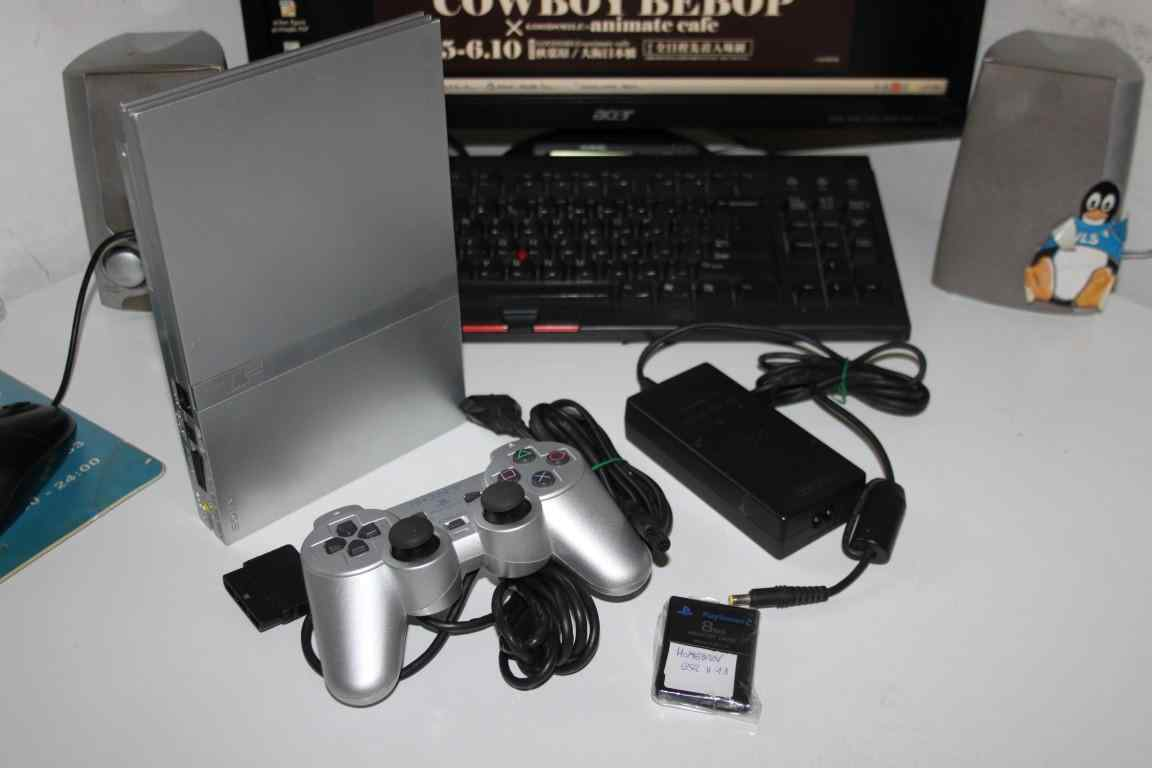 Playstation 2 slim SCPH 7004 grigia metallizzata